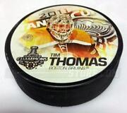 Tim Thomas Puck