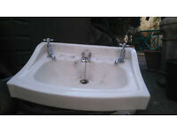 Wash hand basin (possibly Edwardian) with original chrome taps and plug