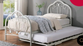 White metal single pull out bed with mattresses