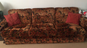 Large couch with floral velour pattern - classic look