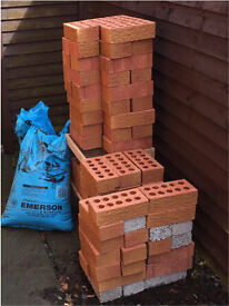 80 red bricks, 12 grey bricks and 1.5 bags of Emerson builders sand