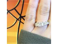 Three stone princess cut silver engagement ring