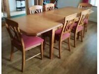 Oak Dining Table with Six Upholstered Chairs