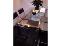 Sophisticated glass dining table with chrome legs (sits up to 6)