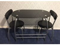 Compact 2 seater glass top bistro / dining table with 2 chairs