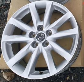 """Genuine Mazda 18"""" Alloy Rim."""