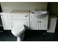 Bathroom suite with Nice sink, toilet and cabinets