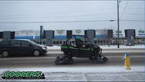 Cooper's is selling Teryx's with tracks.  Save up to $3500