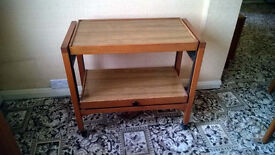 TEAK PULL OUT TROLLEY TABLE ON CASTORS