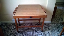 2 TIER TEAK PULL OUT TROLLEY TABLE ON CASTORS
