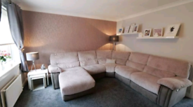 Grey 5 seater corner recliner sofa with chaise lounge.