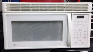 White GE Spacemaker XL1400 above range Microwave