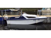 2 berth cabin cruiser with 60hp Mariner outboard