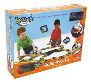 Neuf!  Piste de course Kidoozie Build A Road X-Track New!