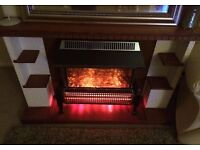 Plug in electric fire with fixed surround