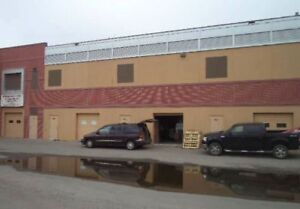 WAREHOUSE/OFFICES FOR SALE. CLOSE TO WESTWINDS LRT STATION.
