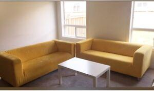 2 Yellow Loveseats & coffee table