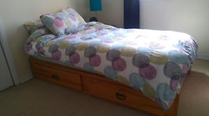 Twin size mattress with wooden bed frame