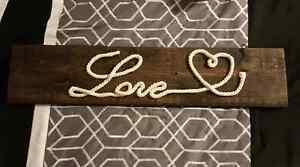 Rustic rope lettered wood sign