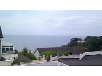 AN 'IDEALLY LOCATED' ATTRACTIVE STUDIO FLAT WITH BALCONY & SEA VIEWS