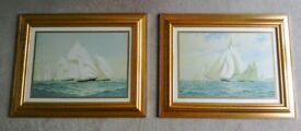 A pair of guilt coloured framed prints, of classic sailing yachts in full sail.