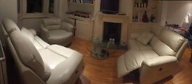 2 Navona Recliner Leather Sofas , Spritzer Swivel chair and a Signet Coffe Table