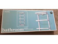 Next wall mounted towel rail. New in box