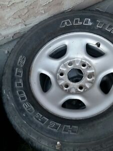 2004 Chev/GMC 1500 rims/tires . 16 Inch. will fit many other yea