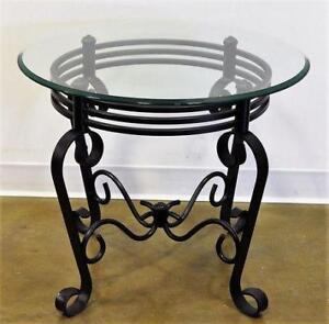 Round End Table with Ornate Base.  $131.25 each
