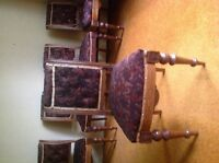 Antique upholstered chairs.