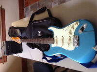 jt- electic guitar with small amp