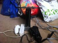 Nintendo Wii + Games and Wii remotes