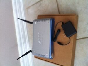 SMC 8014W-G wireless cable modem for use with Rogers