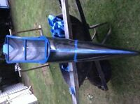 Black and blue one person racing canoe