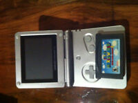 Gameboy Advance SP system with Super Mario Advance 2 game