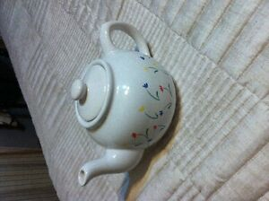 Tea pot with matching cream and sugar