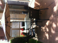 Large outdoor table and eight chair plus umbrella