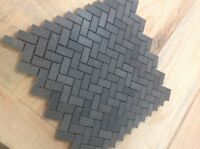 Granite basalt honed herringbone tile