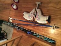 Down hill skis, boots and poles