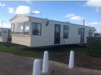 CARAVAN FOR HIRE at CAYTON BAY HOLIDAY PARK.