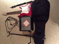 Red 2010 Fender Squier guitar, amp, stand, case and strap