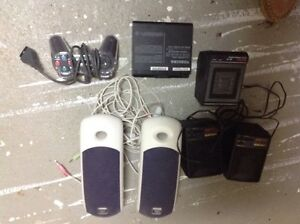 Various mini speakers, laptop battery, game controller
