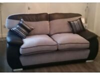 2 x large grey and black sofa with chrome feet. Comes from a pet/smoke free home.