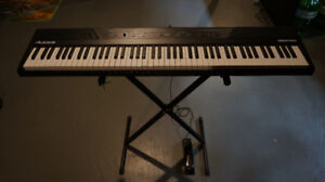 ALMOST BRAND NEW digital piano/keyboard WITH many accessories