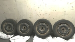 4 Sixteen inch Snow Tires WITH  rims - REDUCED PRICE!