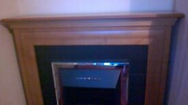 Electric fireplace suite in very good condition. Coals and solid brass gate included.