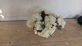 Bowl of artificial flowers