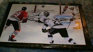 L.A.Kings' goalie J. Quick in action vs Blackhawks' B.Bickell