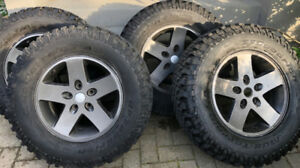 Five Like New BFG Mud Terrain tires on  JK Moab Wheels 255/75/17