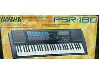 Yamaha electric keyboard with stand and case.